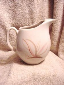 "Winfield Dragon Flower 64 OZ Pitcher vintage china dinnerware California Pottery 8"" tall x 9"" spout to handle x 3"" base diameter. Handpainted Pink Desert Flower on white background.This pattern was discontinued in 1949. The Winfield China Company was established in Santa Monica, Ca. in 1929 and continued making fine dinnerware until 1962. Their lines have a strong Pacific Rim influence, often having rice bowls, sake cups, etc,etc."