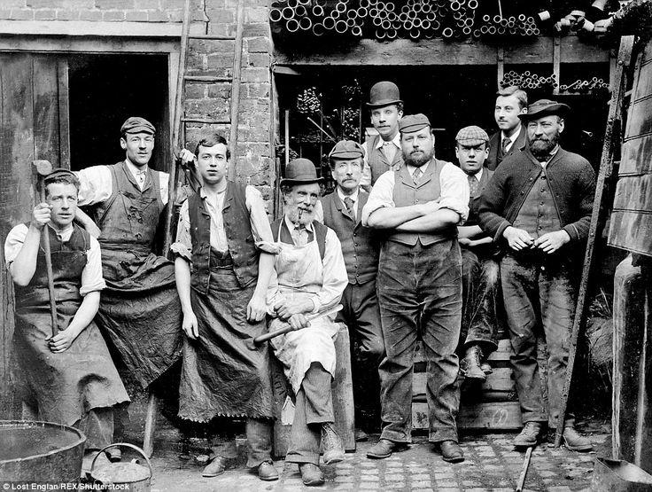 Ironmongers in Maidenhead, Berkshire have their photo taken taken during break in 1900