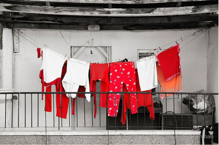 Red laundry by Abba Richman