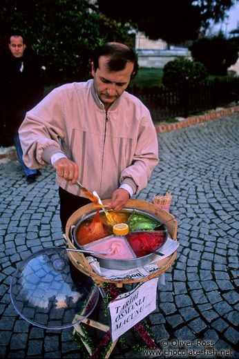 MACUNCU (Seller of sweet paste).  Istanbul, 2010s.  'Macun şekeri' is a Turkish sweet paste sold outdoors. It is a street food, especially for children. Macun is sold during street festivals (panayır); this practice is also common among the Jews of Turkey.