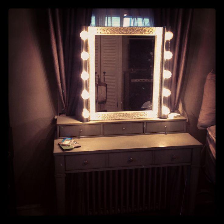 cheap ikea lights + inexpensive home goods mirror+ handy