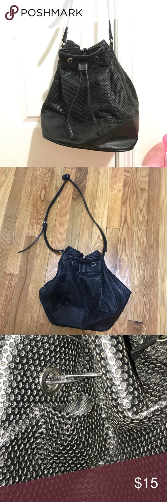 Mango black drawstring bag Used Mango bag. There's a small 1.5-2 inch rip on the back (pictured above). Trying to sell ASAP! Mango Bags Hobos