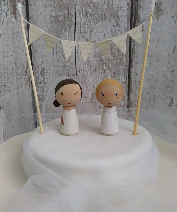 Bride & Bride Cake Topper, Mrs and Mrs Cake Topper, Personalised Cake Topper, Gay Wedding, Civil Partnership, Hers n Hers, Lesbian Wedding  This listing is for a custom Bride & Bride Wedding Cake Topper (the picture is an example). *The bunting is not included in the price but can be purchased separately*  I welcome custom orders and can personalise the Brides, dress style, hair, dress & eye colours. When completing checkout leave a note to seller with your colour choices and any ...
