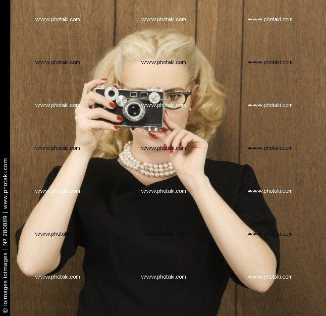 http://www.photaki.com/picture-woman-with-a-vintage-camera-square-mid-adult-woman_280889.htm