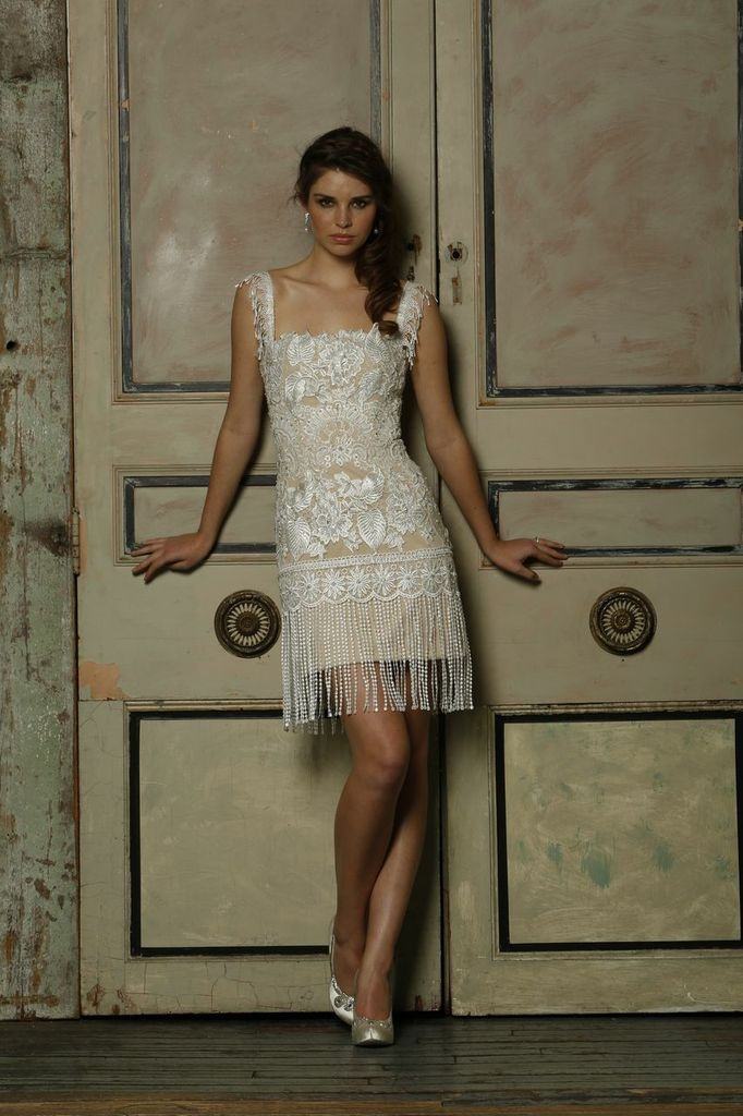 Jovani has featured the perfect vintage inspired engagement dress that is timeless. Infused with a tassel inspired hem-line, intricate top lace over nude shell body, flattering square neckline, and delicately trimmed shoulder straps, this short dress has embraced the 1920's era with a modern day twist.