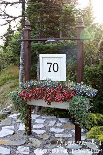 A DIY house number sign including a flower box that myself & my husband came up with.