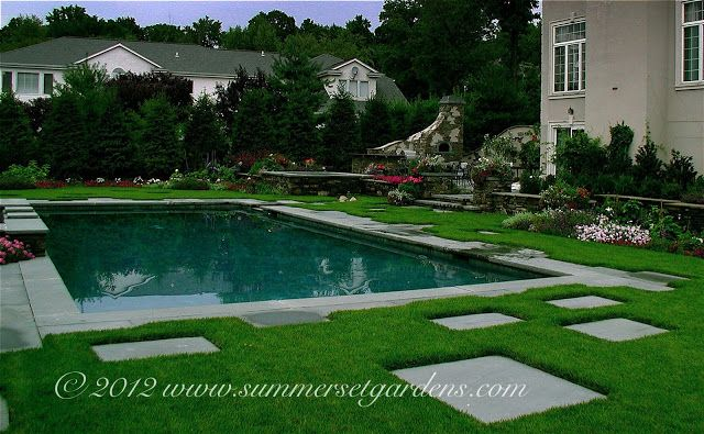 A simple rectangular swimming pool with some interesting for Swimming pool surrounds design