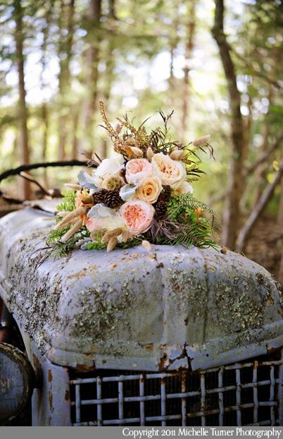 Wedding flowers and a rusted antique tractor.