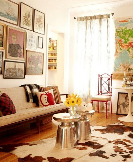 There's a bold mix of styles in this small Brooklyn apartment, not to mention one powerful art collage and a boldly patterned floor rug. But what helps this space seem enjoyable rather than too busy to be in is the subdued color palette that dominates and subdues.
