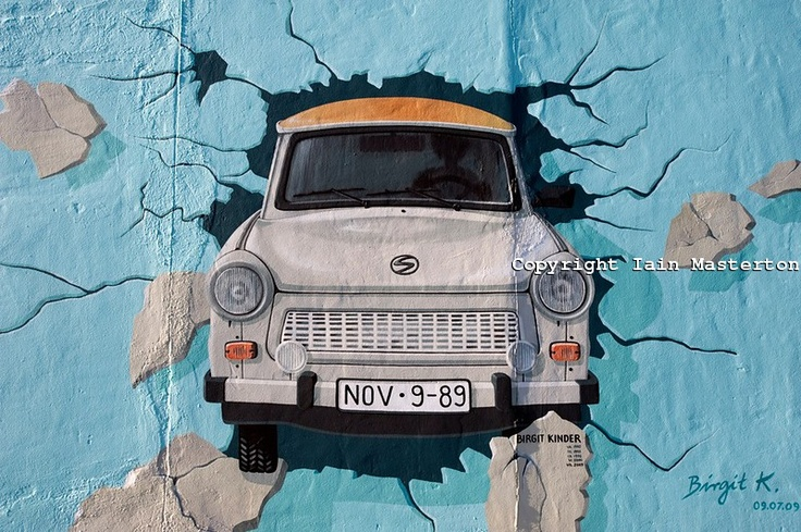East Berlin.  Painting of the iconic East German Trabant car on the Berlin Wall