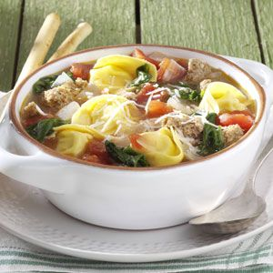 Rustic Italian Tortellini Soup Recipe -This is my favorite soup recipe. It's quick to fix on a busy night and full of healthy, tasty ingredients. It originally called for spicy sausage links, but I've found that turkey sausage, or even ground turkey breast, is just as good. —Tracy Fasnacht, Irwin, Pennsylvania