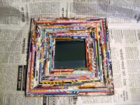 recycled reflection:  mirror framed by magazine strips