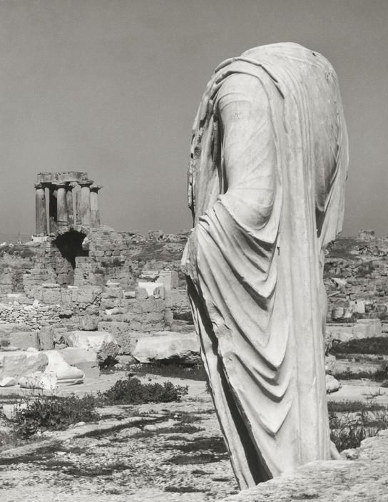 Statue and Temple of Apollo in the background - at the Ancient Corinth, Peloponnese, Greece, photo dated 1937