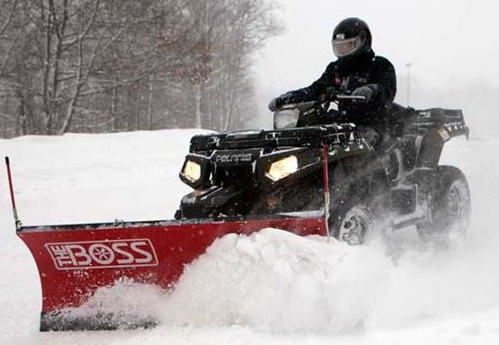 The Boss fully hydraulic ATV plow with a poly blade..