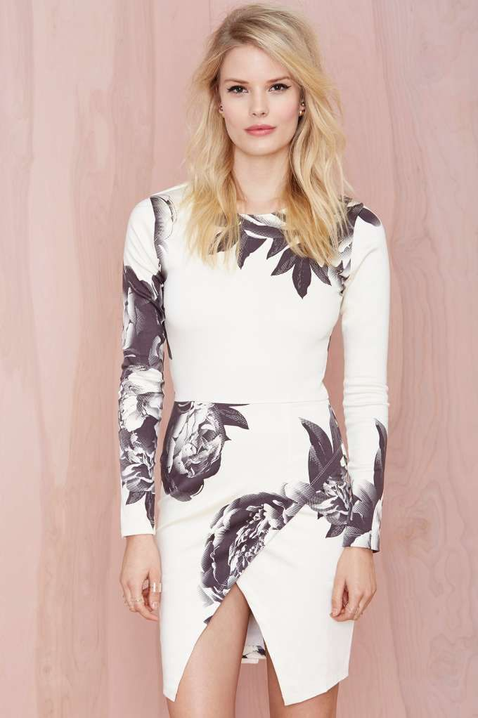 Take your floral addiction to the next level in this ivory dress featuring a gray floral print and asymmetric wrap skirt.