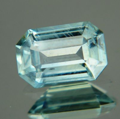 Gemstone: Montana Sapphire - Carat: 1.86 - Comment: This emerald shape has a distinct silvery sheen caused by very fine needles sitting in perfect parallel order throughout the stone.  http://wildfishgems.com/inc/sdetail/15452