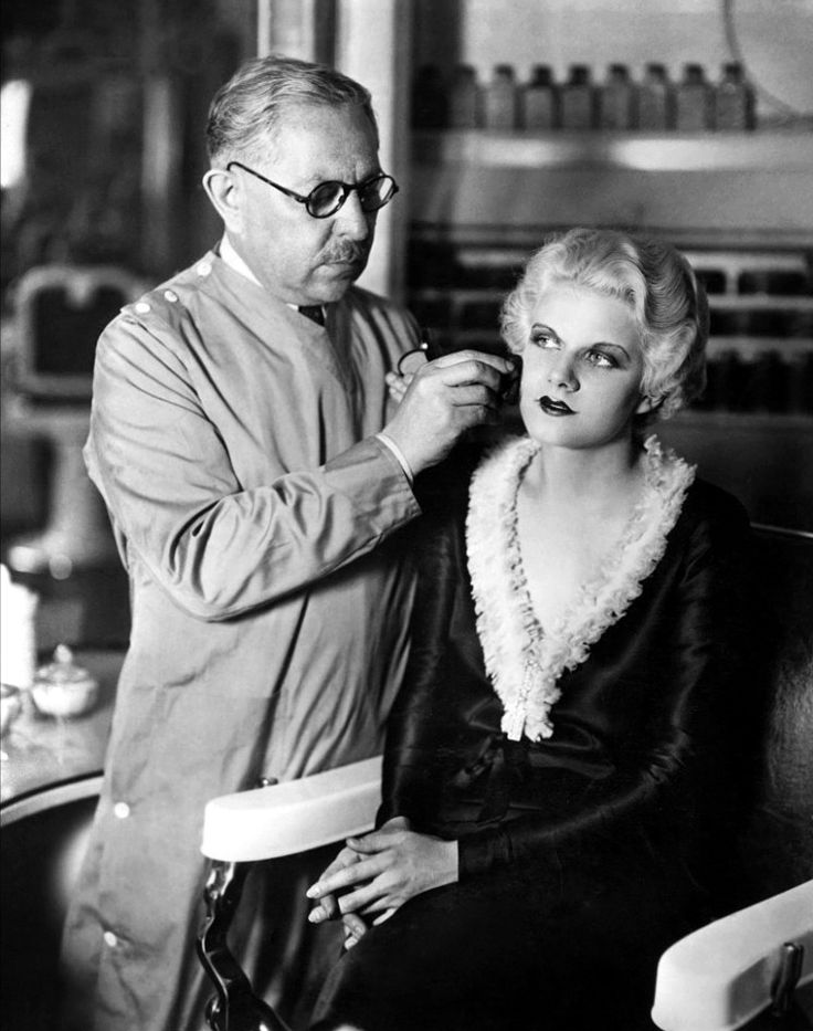 Jean Harlow getting made up by Max Factor.Max Factor:  Born Max Faktor in Lodz, Poland during the 1870s, Max Factor is often called the father of modern makeup. In 1914, Max Factor created a makeup specifically for movie-actors that, unlike theatrical makeup, would not crack or cake.