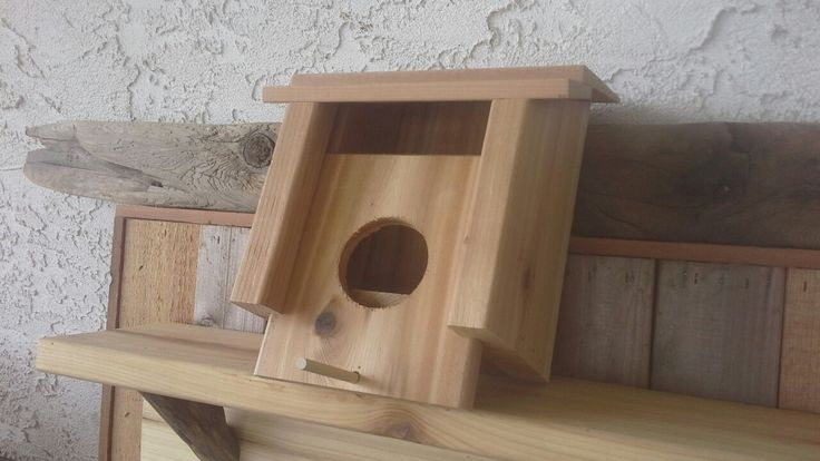 Bird house. Pull out perch to slide down front for cleaning or hide a key.