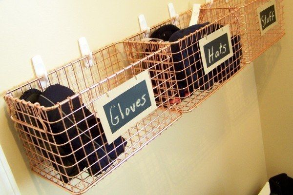 Hang wire baskets on the wall near your door to keep gloves, hats, and even your purse easily accessible.