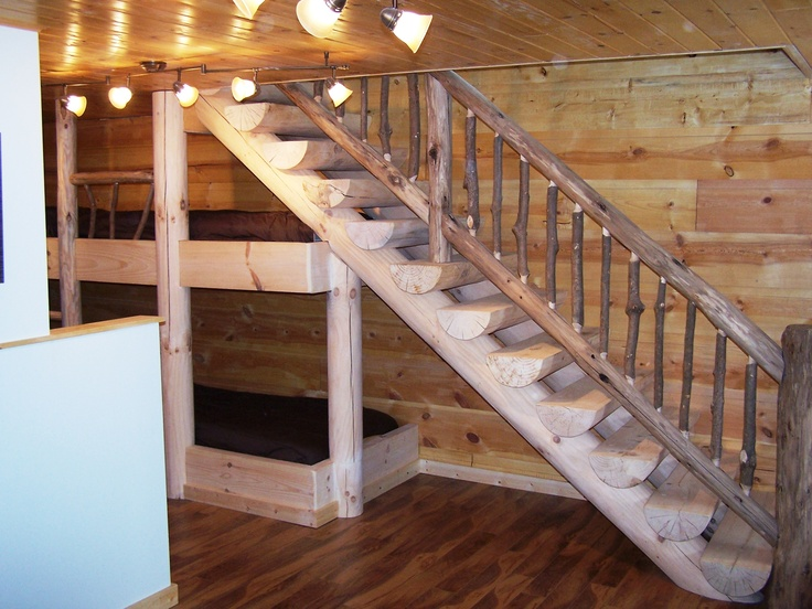 Custom log stairs with built in bunk beds.