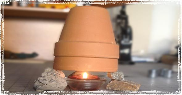 Building a small Clay Pot Radiator allows you to capture the heat generated from a candle, and slowly build it up inside a makeshift radiator. The heat can be used to heat a small closet during a winter weather emergency.