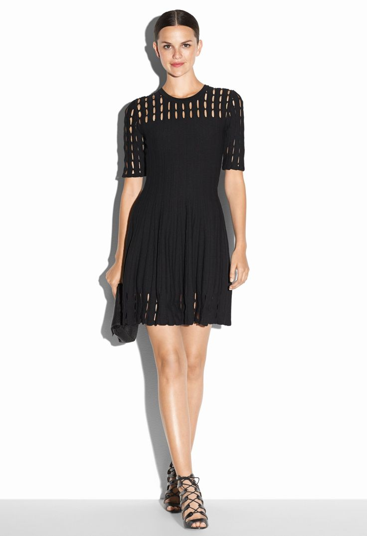 Milly  Couture tech flare dress Couture Tech Flare Dress. Elbow sleeve, crew neck knit dress with open yoke and sleeves. 100% nylon.  The graphic fabric detailing on this flare dress adds a sophistocated flare to its feminine silhouette.