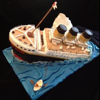 Side view of sinking titanic birthday cake by pamycakes