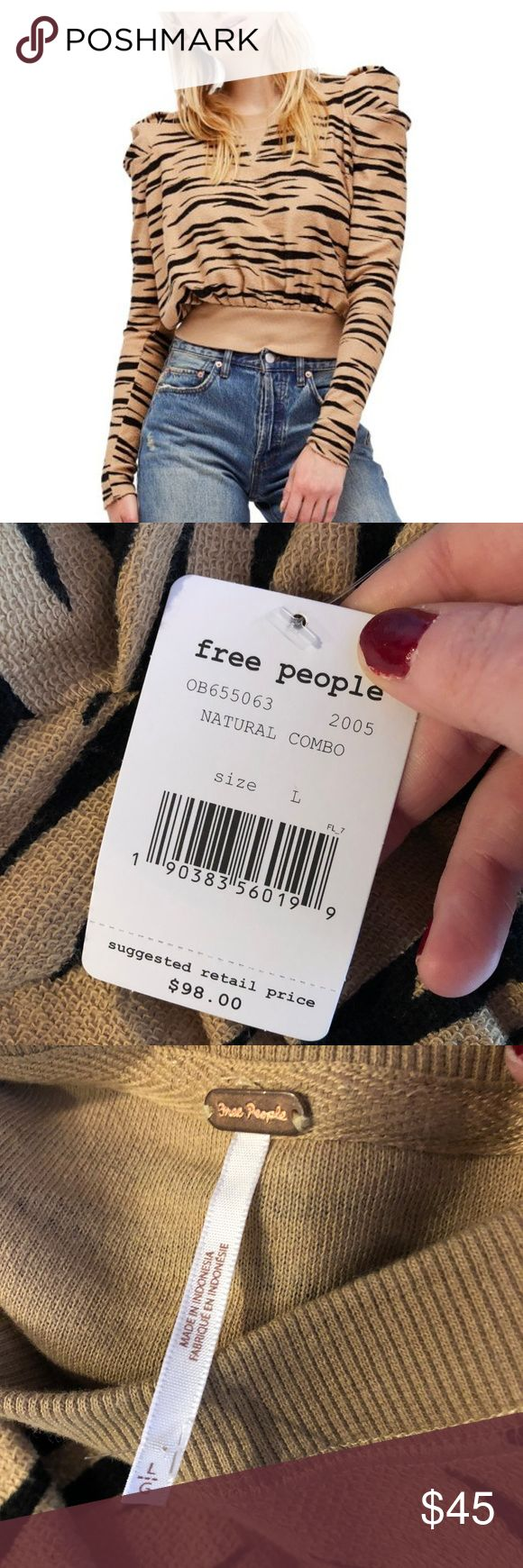 """Free People ZaZa Zebra pullover sweatshirt Free People Women's ZaZa Zebra women's puffy shoulder pullover sweatshirt with zebra animal print. Size large. Retails for $98. Tags are attached but some pulls to fabric.  armpit to armpit-24"""" overall length-25""""  I211 Free People Tops Sweatshirts & Hoodies"""