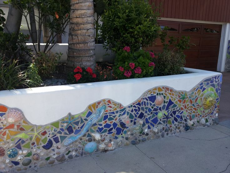 mermaid wall mosaic. This would be cool on the side of a bathtub, too!