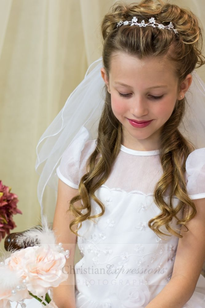Organza allover shamrock embroidered first communion  dress and bodice with floral waist trim.  Back includes Zipper with satin buttons and bow. Fully lined. Matching veil and accessories sold separately.  Petticoat available for added fullness as shown in photos