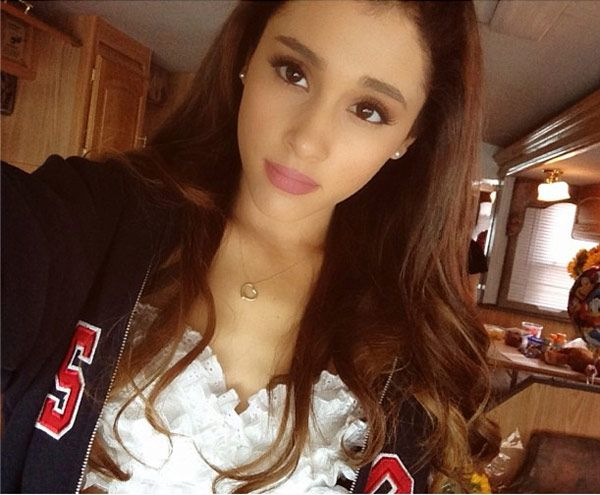 Do you like Ariana's hair half-up or down better?