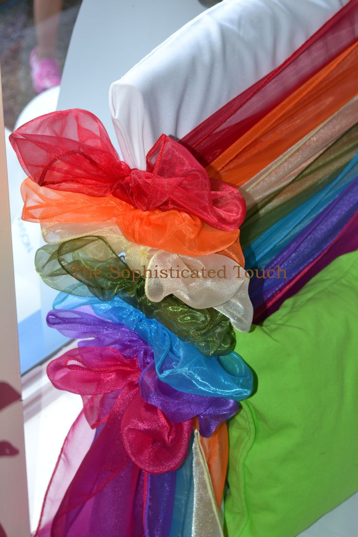 Rainbow Chair Bows on White Chair Covers  The Sophisticated Touch ...Chair Covers by Design