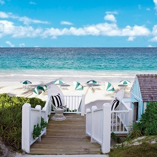 White sand, turquoise waters, striped umbrella, wooden boardwalk, big fluffy clouds... this is my kind of place.