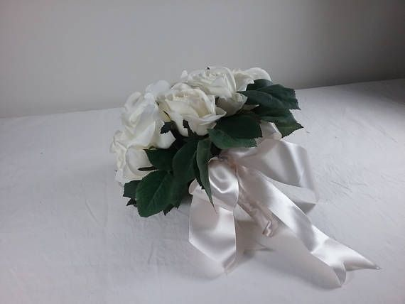 Gorgeous White Rose Bouquet for Bridal boquets or table arrangements Quality silk flowers Brand new  All my boquets are Hand made by me.  I have been a florist for 35 years and love my job.  I have sold Bouquets and wedding arrangements to the most remote parts of Australia, especially where fresh flowers are not available, and for those who want an everlasting keepsake of their special day. My faux flowers are made of quality products.  The items listed are one offs   Postage listed is…