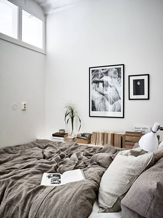natural woods with a neutral taupe / gray color bedding.