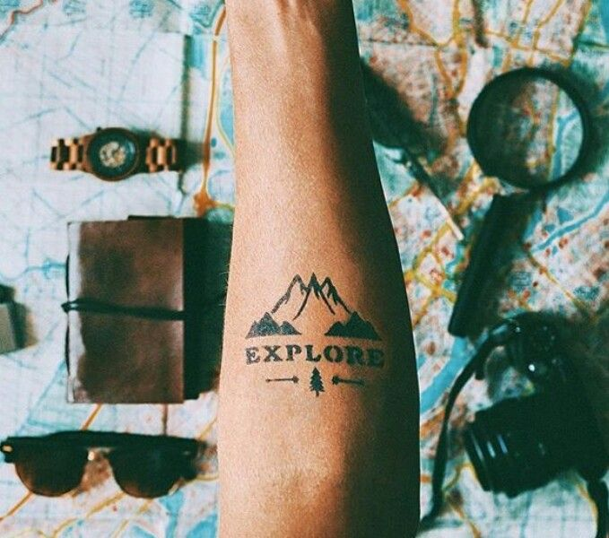 """explore"" tattoo with mountains and a pine tree on forearm, pin: morganxwinter"