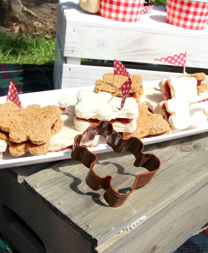 Planning a teddy bear's picnic? Use a teddy bear cookie cutter to make these cute teddy bear sandwiches. Perfect for a picnic party or summer celebration, finish them off with cute red food picks.
