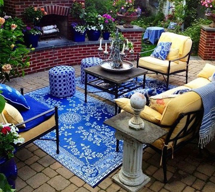 blue and yellow warm traditional outdoor living area 04_upgrade-outdoor-space-for-summertime-entertaining-with-area-rugs-from-carinilang.com-62
