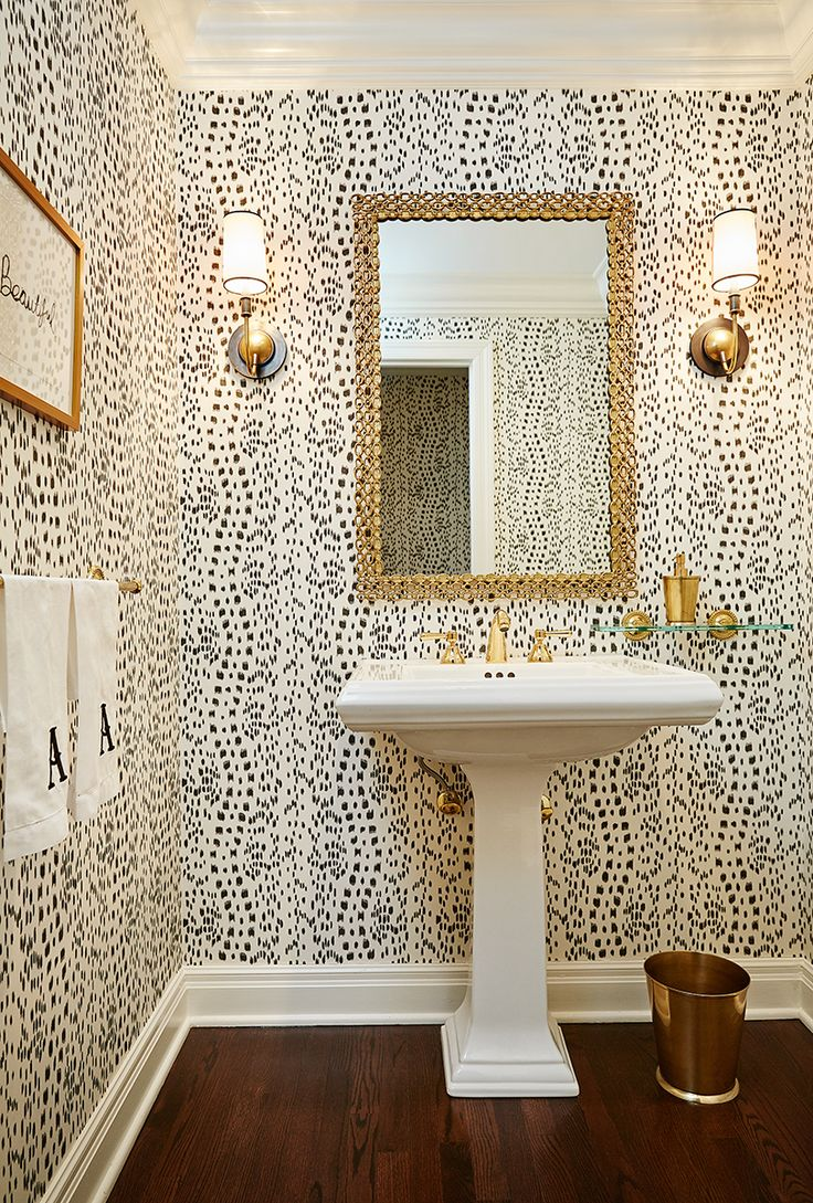 White and blue powder room features walls clad in trim molding framing - Love This Powder Room Such Fun Wallpaper Print And Love The Gold Sconces