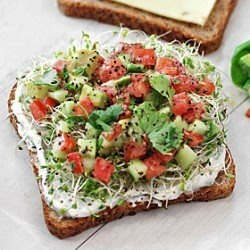 This California open-faced sandwich looks absolutely delicious! It has avocado, tomato,sprouts,pepper jack and chive spread (but I would substitute the chive spread and instead use hummus).