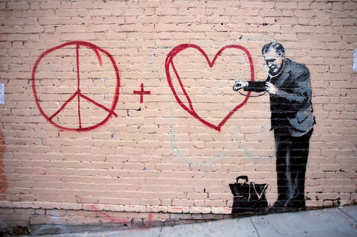 Banksy images.  Sadly this no longer exists.  It was in Chinatown in SF.  In order to preserve it the city covered it in plexiglass.  Then, someone poured paint under the plexi.  Now the entire wall has a dragon painted on it.