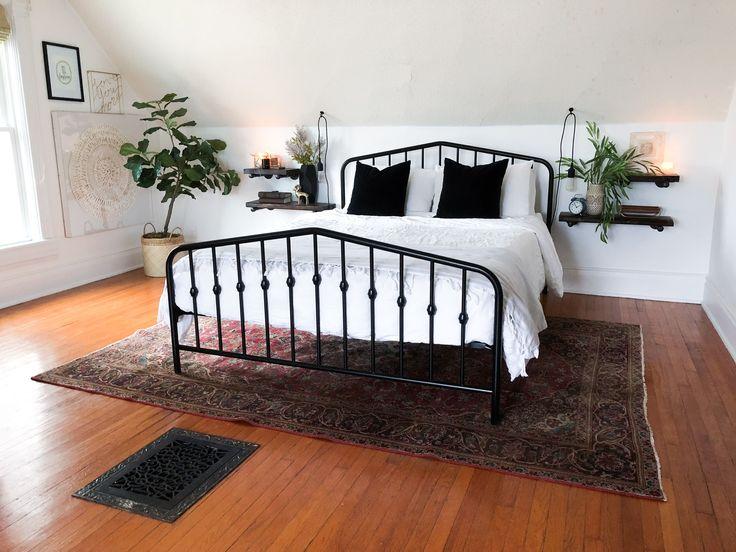 Modern vintage, black metal bed frame, vintage rug…