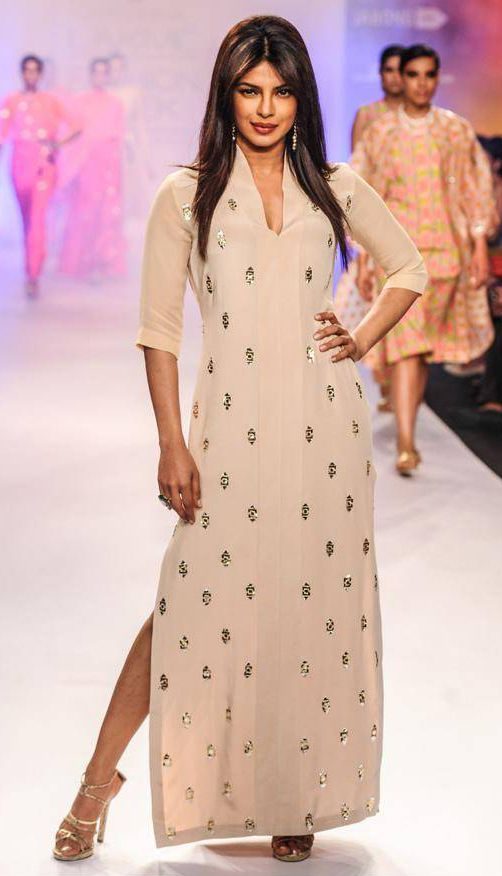 Bollywood diva Priyanka Chopra showcases a design by Neeta Lulla .