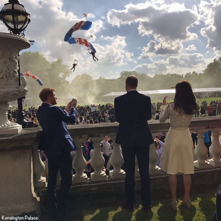 Kensington Palace with RAF paratroopers - Prince William and Kate with Prince Harry