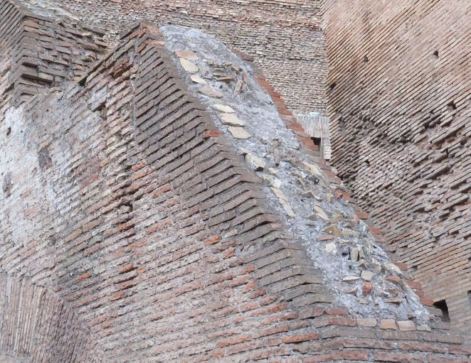 the ancient Roman concrete combination of limestone, volcanic ash, and seawater required far less heat (which means far less fuel) for solidification...