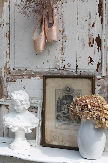 Random idea - if you found a door, lol, you could use it behind a dresser or mounted horizontally to display. A slender shelf with slippers, a cute hook with tutu on hanger, all haphazard and uneven...hard to put my vision into words lol