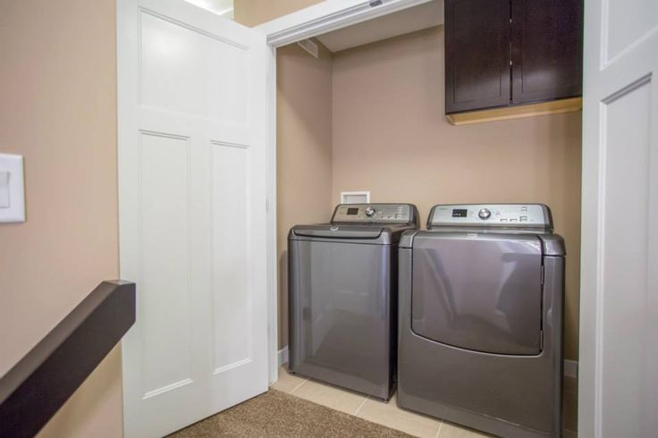 Laundry closet with upper cabinets.