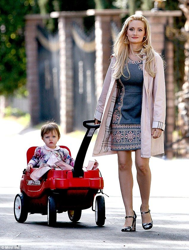 Family first: Holly Madison pulled her daughter Rainbow on a red wagon in her Las Vegas ne...