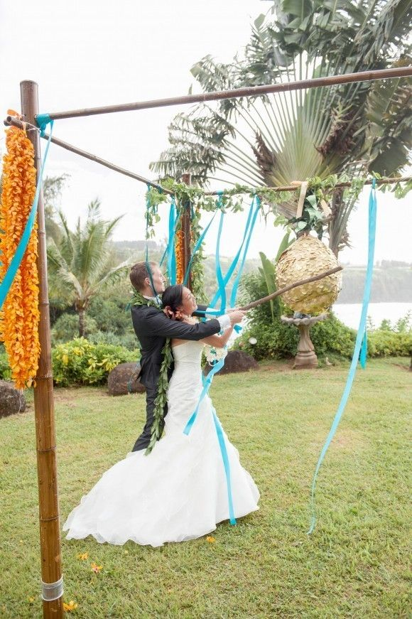 A pineapple wedding piñata filled with RayBan sunglasses in place of cake and favours!