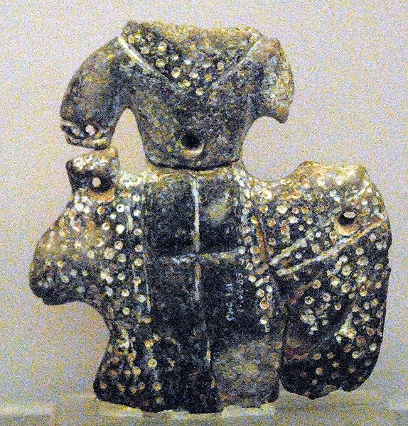 Catal Huyuk in Turkey, Goddess of Leopards, 6.000-5.500 BCE | Statuette made of blue limestone representing a goddess seated upon a spotted leopard